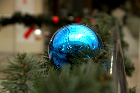 trade off: Christmas decoration of shopping center spheres, bows and branches of a fir-tree Stock Photo