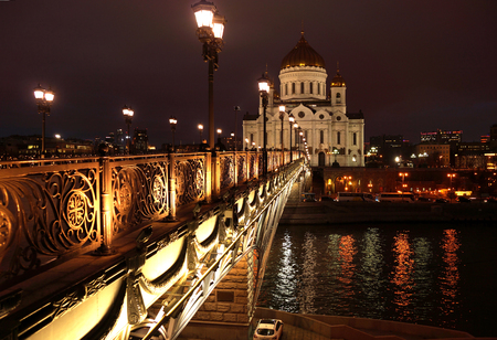 magnificence: Night landscape the bridge through the Moskva River and the Cathedral of Christ the Saviour in the city of Moscow Stock Photo