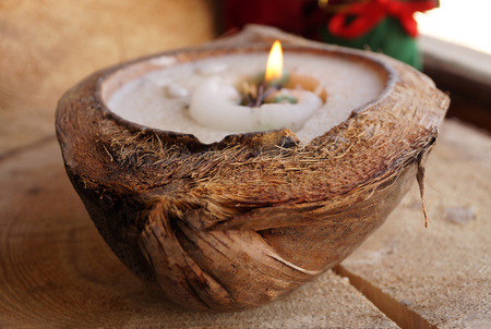 Decorative wax a candle in a natural coconut Stock Photo