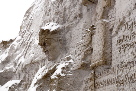 Defenders of Stalingrad, a fragment of a bas-relief of Wall ruins on Mamayev Kurgan in the winter Stock Photo