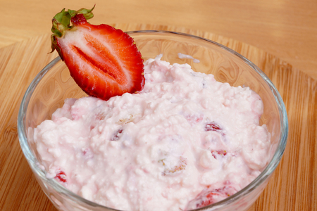 Berry curds with strawberry in transparent capacity