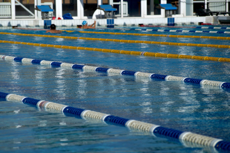 Dividers of paths in the big outdoor swimming pool Stock Photo