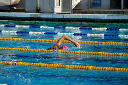Girl swimmer in the outdoor swimming pool Stock Photo