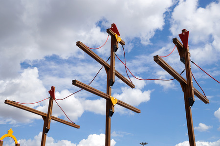 Wooden masts of the childrens ship on a playground