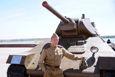 Fighter of Red Army in the form of times of World War II at the T-34 tank Stock Photo