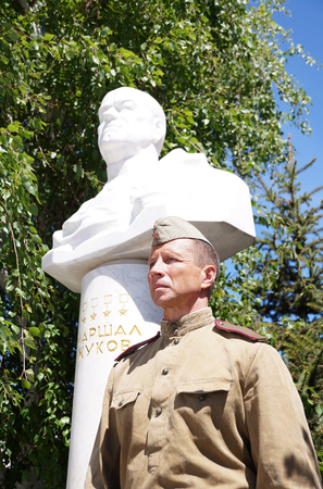 Fighter of the Red Army in the form of times of World War II with a bust of the marshal Zhukov with an inscription