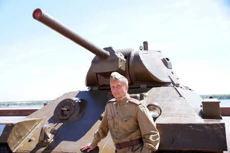 Fighter of Red Army in the form of times of World War II at the T-34 tank Editorial