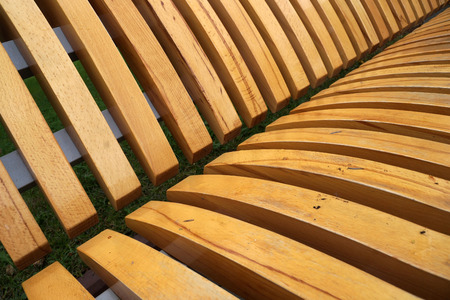 laths: Wooden laths on a seat mat and on a back of a city shop