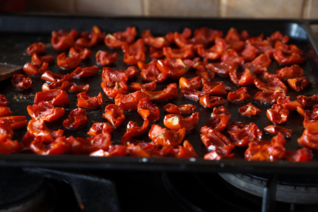 Tomatoes dried in house conditions in an electric oven. Stock Photo
