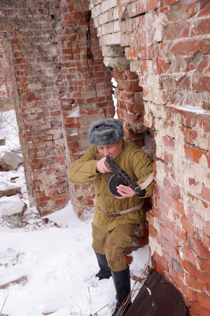 Fighter of Red army with the PPSh machine gun in ruins of Stalingrad (a staff of a division of Lyudnikov)
