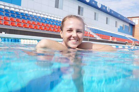 Girl swimmer in the outdoor swimming pool Reklamní fotografie