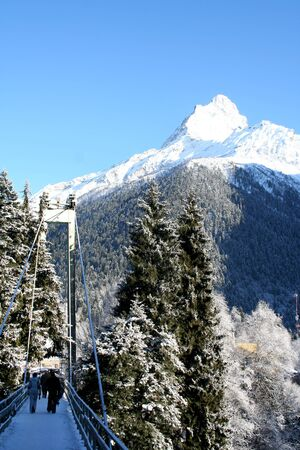 The bridge through the gorge in the mountains of Dombai, Caucasus