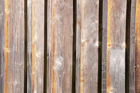 Decorative panel from wooden boards on a house wall 版權商用圖片 - 143650223