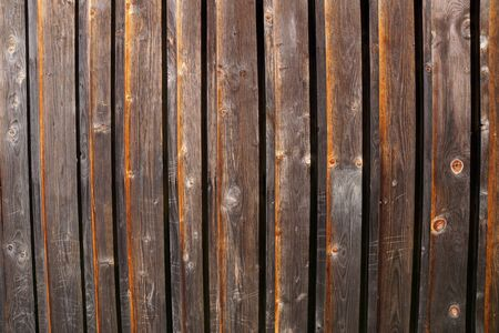 Decorative panel from wooden boards on a house wall