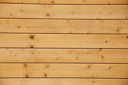 Decorative panel from wooden boards on a house wall 版權商用圖片 - 143650232