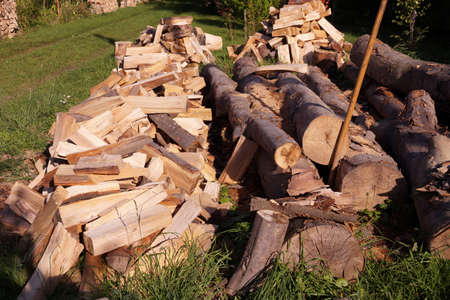 A pile of chopped wood for a stove in a country cottage Stock Photo