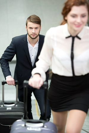 Young business people with a suitcase and plane tickets to travel to the airport trip photo