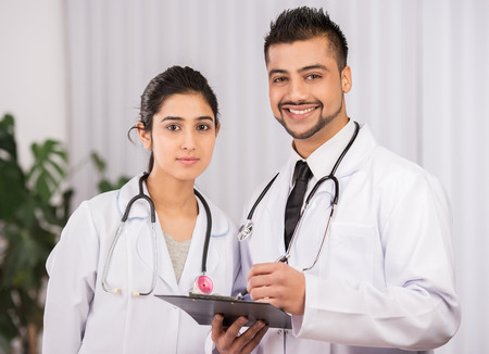 nurses station: Two Indian doctors sitting working  together