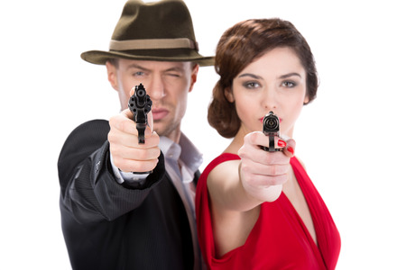 Man gangster and sexy spy woman with guns. Isolated on white background Stock Photo