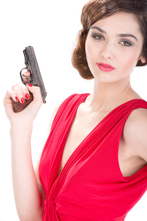 Gangster woman with pistol isolated on white background photo