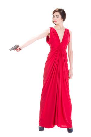 mujer con pistola: Mujer del g�ngster con la pistola aisladas sobre fondo blanco