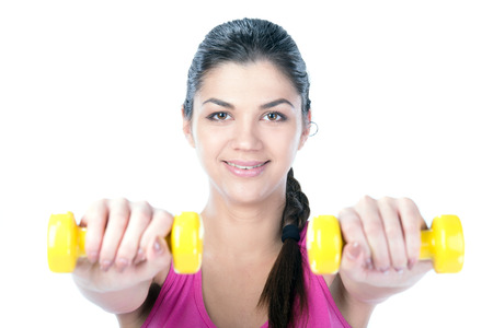 dumb bells: Fitness woman working out with dumbbells. Isolated on white .