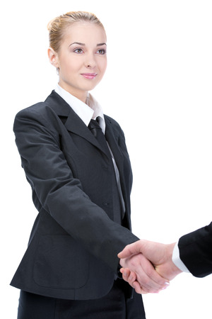 Portrait of young businesswoman shaking hands photo