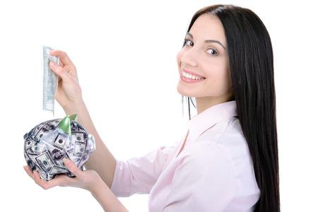 coinbank: El ahorro de dinero Mujer de negocios en una alcanc�a