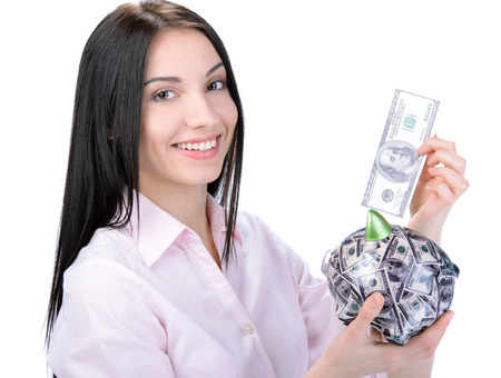 coinbank: Business woman saving money in a piggybank