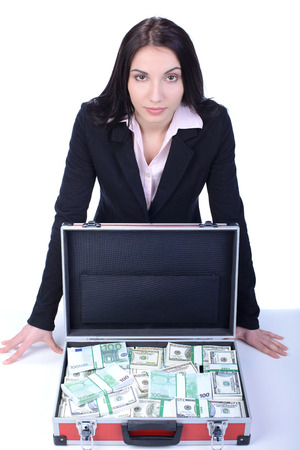 Young beautiful business woman presenting a lot of money on white background photo