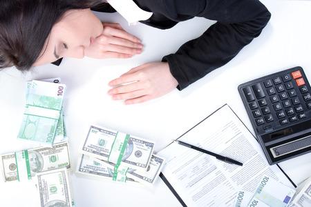 Beautiful accountant using calculator to count cash Stock Photo