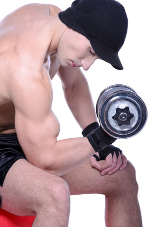 Muscular guy doing exercises with dumbbells over white background Stock Photo