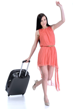 Full length of young female in casual walking with the travel bag, isolated on white background photo