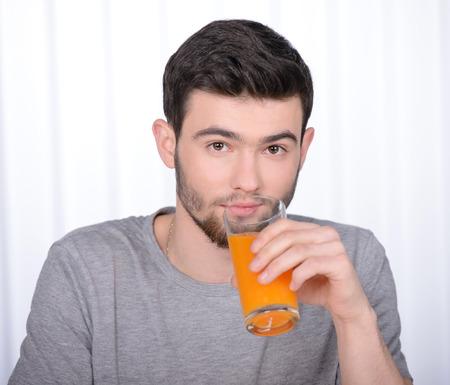 good looking man: Good looking man drinking orange juice in his home