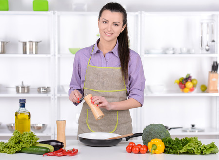 Young Woman Cooking. Healthy Food - Vegetable Salad. Diet. Dieting Concept. Healthy Lifestyle. Cooking At Home. Prepare Food Stok Fotoğraf