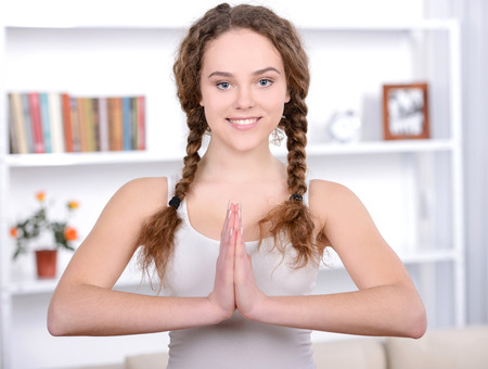 Portrait of young beautiful woman making fitness at home photo