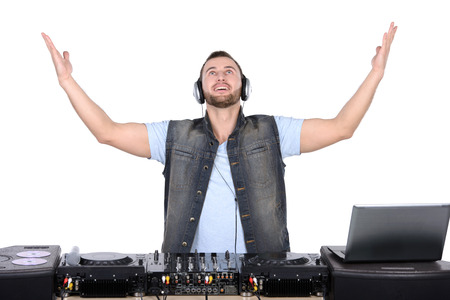 audio mixer: Cool DJ at work  Happy young men spinning on turntable while isolated on white