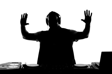 turning table: DJ silhouette  Silhouette of DJ gesturing and spinning on turntable