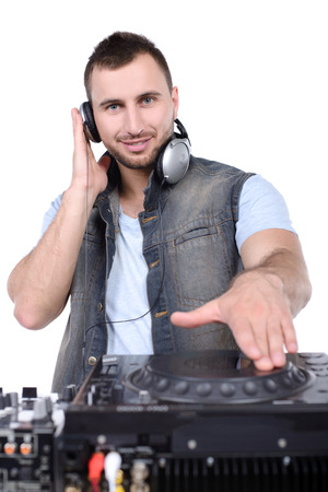 Cool DJ at work  Happy young men spinning on turntable while isolated on white photo