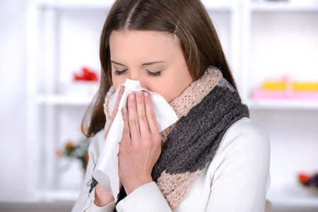Sick Woman.Flu.Woman Caught Cold. Sneezing into Tissue. Headache. Virus .Medicines photo