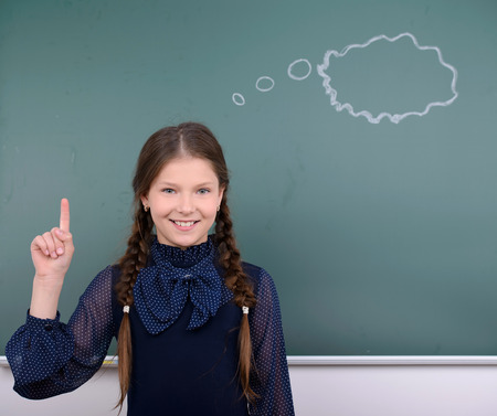 Portrait of child school education against the background of blackboard photo