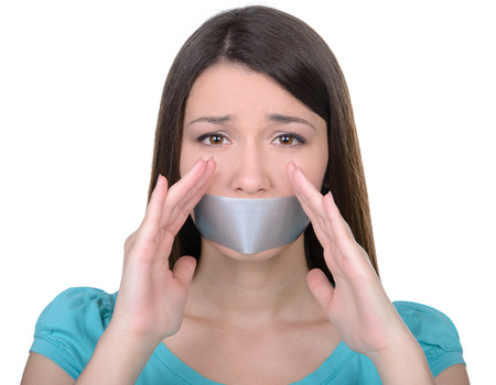 It is better to be silent. Upset girl with self-adhesive tape over her mouth photo