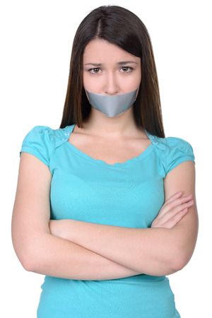 It is better to be silent. Upset girl with self-adhesive tape over her mouth