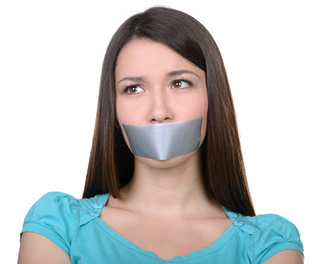 scotch tape: It is better to be silent. Upset girl with self-adhesive tape over her mouth