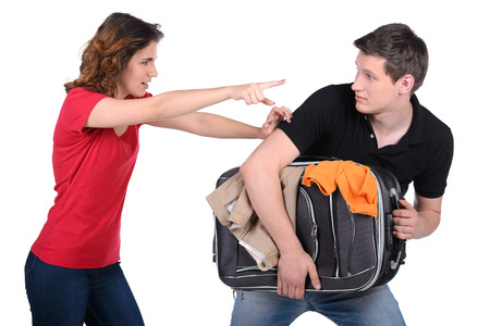 apartmant: Go away! Jealous woman asks her husband to go out and stuff it in a suitcase Stock Photo