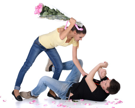aggressive people: Jealous young woman beat her boyfriend bouquet of flowers for lipstick on your face