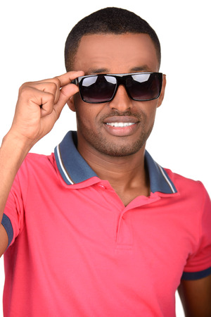 Handsome young fashionable attractive african man wearing sunglasses, isolated on white background photo