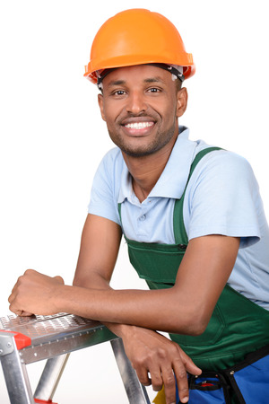 African male worker carrying toolbox over white background photo