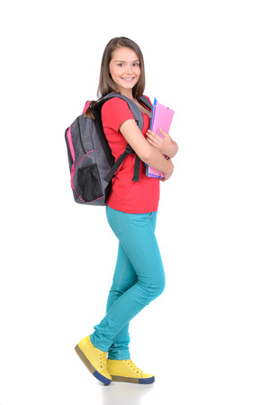 nice girl: Portrait of teenager girl with school backpack holding colored folders isolated on white background