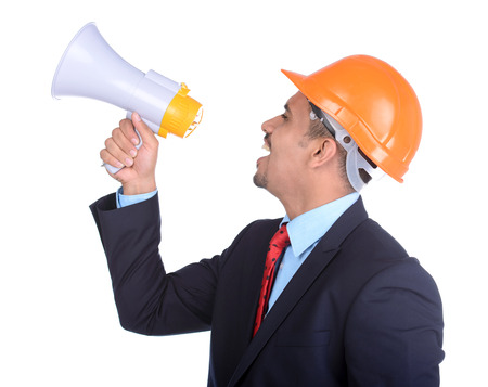 asian architect: Happy young Asian engineer architect, screaming in megaphone against a white background and clipping path Stock Photo